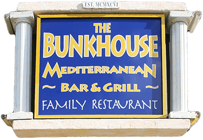 Bunkhouse Restaurant blue logo with two white pillars
